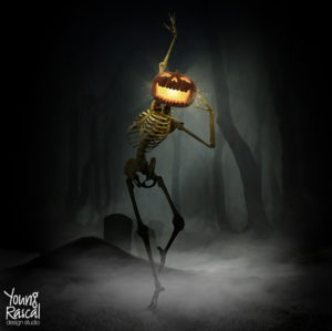 Young Rascal Halloween themed Photoshop manipulation of a glowing pumpkin, with a skeleton body, dancing through a dark misty graveyard.