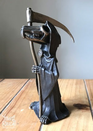 Young Rascal sculpture of Terry Pratchett's 'Death of Rats'. Compete with small scythe, this black robed rodent grins a skeletal, cheeky grin.